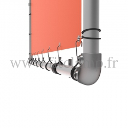 Wall mounted display frame with tension banner on aluminium tubular structure. Detail of tube clamp fitting 125. FitClamp.