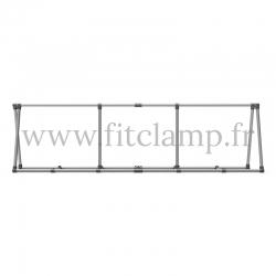 Cadre d'affichage inclinée avec deux renforts pour bâche tendue