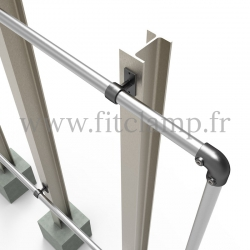 Large display frame for tension banner on aluminium tubular structure.  Foot type: tube clamp fitting 143. FitClamp.