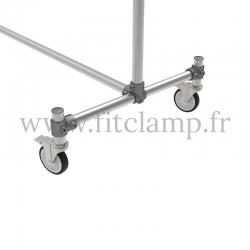 Porte-vêtements double largeur en structure tubulaire acier galvanisé. Piètement raccord tubulaire roulette. FitClamp