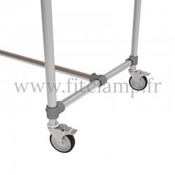 Table renforcée en structure tubulaire B34 acier galvanisé. Piètement raccord tubulaire roulette. FitClamp